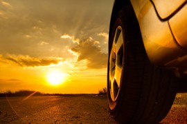 Close up shot of a car against sunset in the background; Shutterstock ID 76015177
